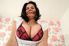 Big breasted British mature slut getting very naughty