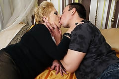 Horny grandma sucks her toyboys cock and gets fucked hard