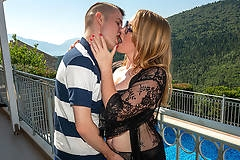 Big breasted MILF fucked anally on a balcony in Spain